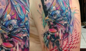 Big arm watercolor style colorful bird tattoo pattern