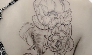 Tattoo black girl behind flowers and elephant tattoo pictures