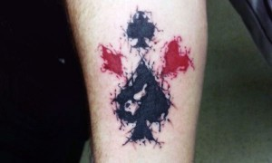 Simple watercolor poker sign sign arm tattoo pattern