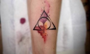 Simple set of watercolor triangle tattoo pictures