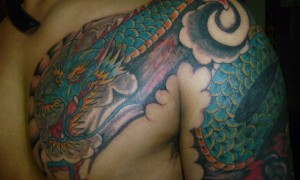 Colorful Dragon Tattoo On Chest And Shoulder
