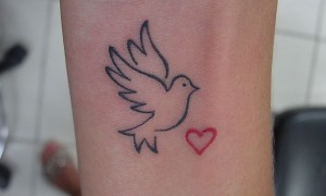 Tiny Red Heart and Dove Tattoo On Forearm