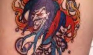 Shoulder color clown in flame tattoo pattern