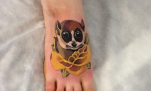 Foot, lovely colorful lemur and yellow rose tattoo pattern